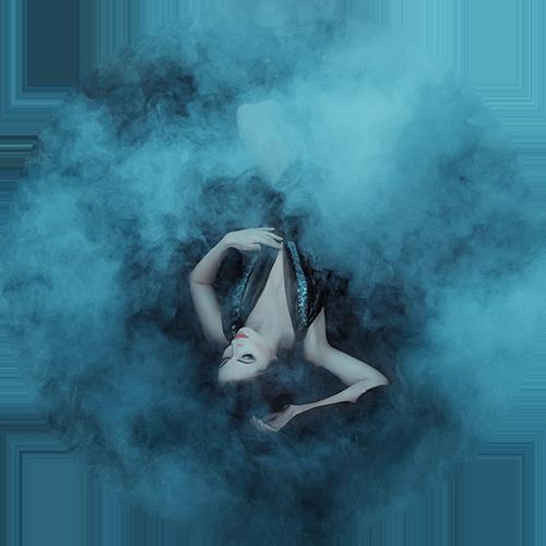 Woman dissolving into fog