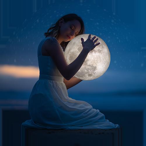 woman hugging the moon